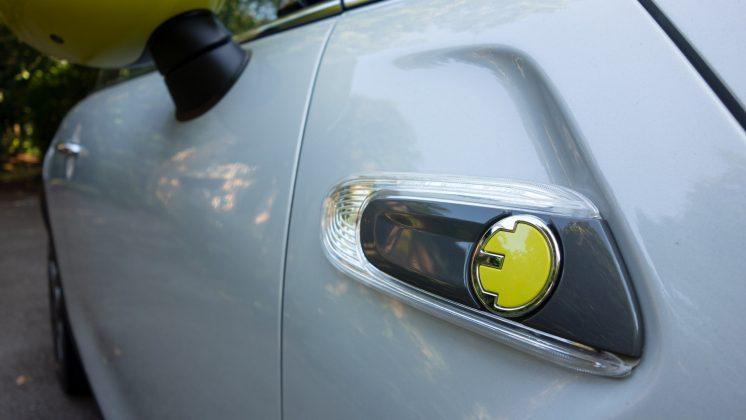 Mini Electric yellow badge